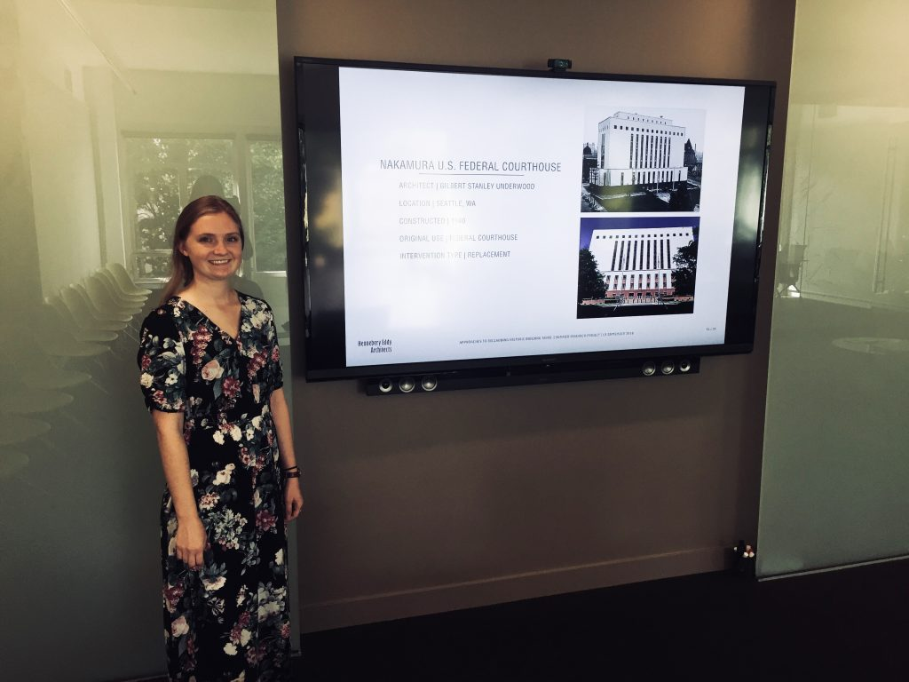 Shannon Hines presents her summer research project on building recladding methods at the end of her historic preservation internship.