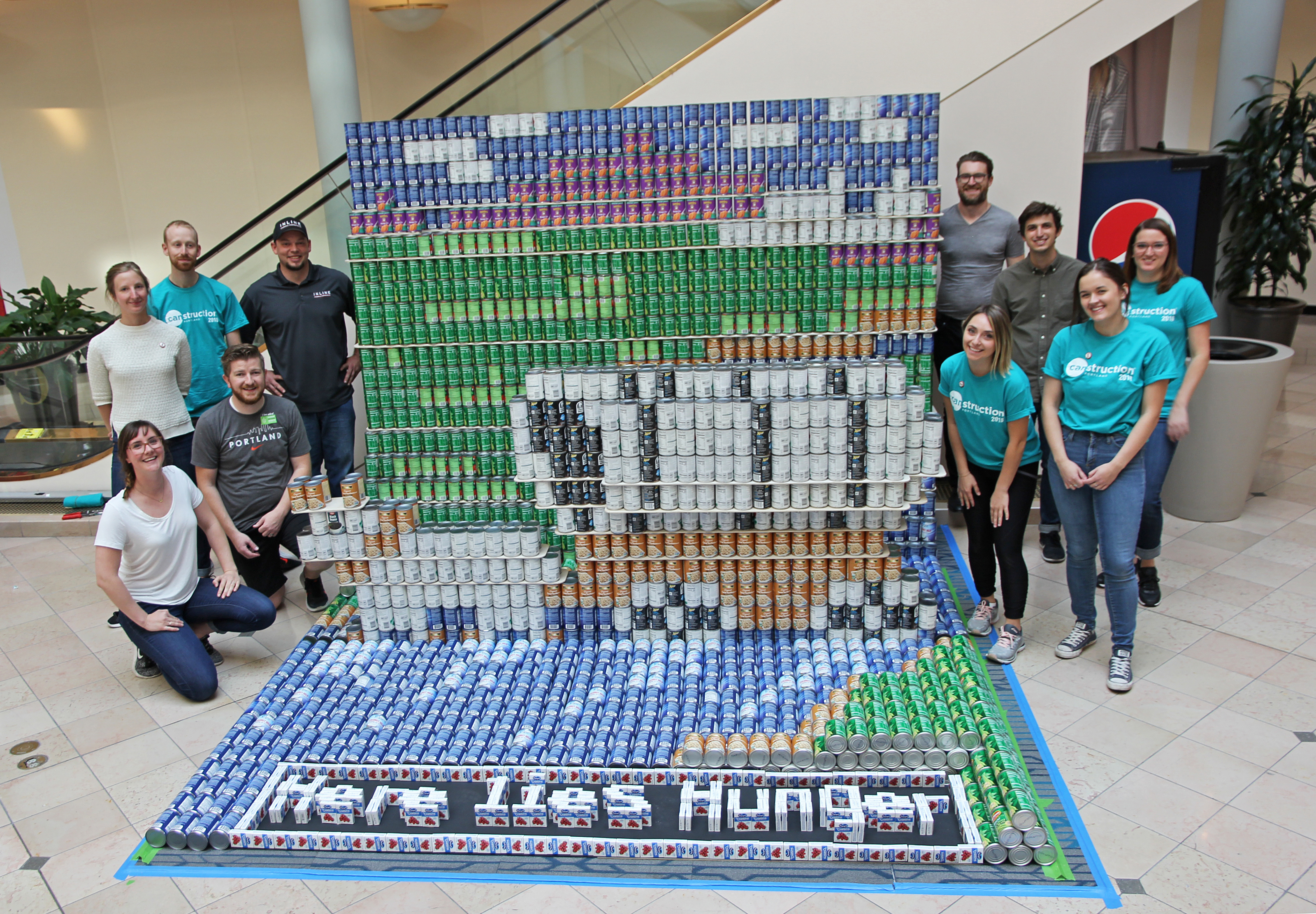Here Lies Hunger Canstruction Portland Hennebery Eddy community service architects INLINE