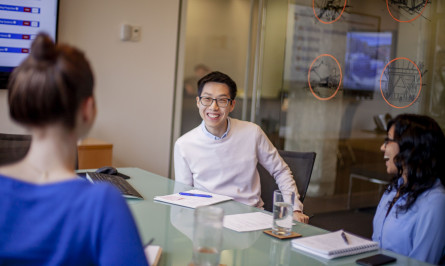 Net Positive Intern Eugene Leung works with the Net Positive Committee